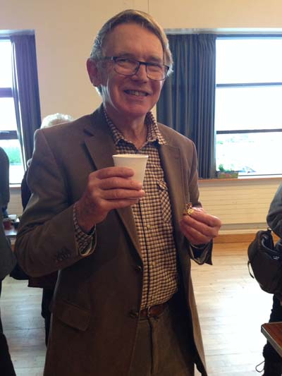 Liam McCaughey, past Chairman of the Alpine Garden Society Ulster Branch and a member of IGPS, enjoying the tea and home made cakes after the lecture.