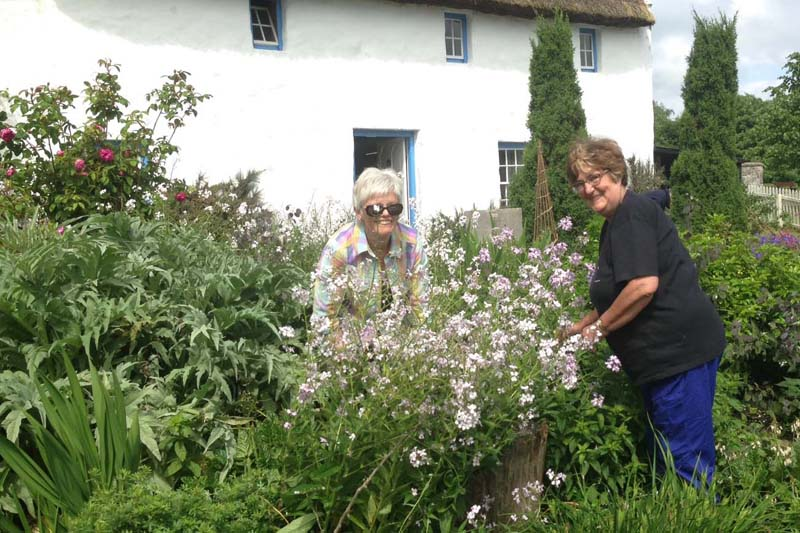 Volunteers Maureen Reid and Marion Allen busy working in the borders