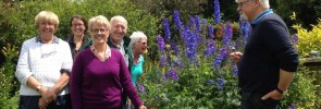 Victor Henry greeting the visitors as all admire the wonderful delphiniums.