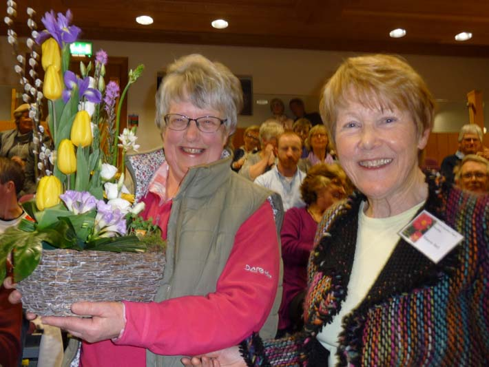 Hilary Glenn (left) and Maeve Bell (right) after Maeve presented flowers to Hilary to mark the completion of her 10 year term on the regional committee.